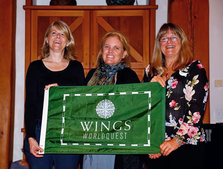 At the September 2013 meeting of the Canadian Chapter of the Explorers Club, Capt. Lynn Danaher (R) passes WINGS Worldquest expedition flag to Susan R. Eaton (L), Founder/Expedition Leader of the 2014-2016 Sedna Epic Expedition. Milbry Polk, author, explorer and founder of WINGS Worldquest and Fellow of the Explorers Club, is in the centre.